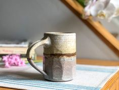 This stoneware mug's carved design and shapely handle feel great in hand. Gentle glazes are soft and quietly beautiful.