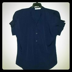 Navy Blue Short Sleeve Shirt Navy blue short sleeve button down shirt.  Made of a silky material with just little stretch. Perfect for the office or paired with jeans. Tops Blouses