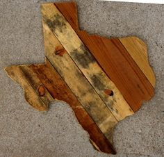 Large Texas wall hanging made by L.J. with old pallet and fence wood.