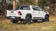 2018 Toyota HiLux Rugged X manual review - photos | CarAdvice Toyota Hilux, Manual, Rugs, Photos, Farmhouse Rugs, Pictures, Photographs, Floor Rugs, Rug