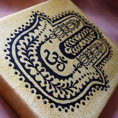 Black hamsa on gold canvas by Henna on Hudson