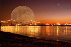 Goddess Moon over Mississippi River bridge, Baton Rouge Louisiana...Jerrie Ann's hotel suite always overlooks this part of the river.