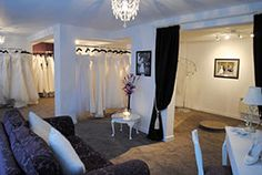 Bride by design - wedding dresses - shop interior: Love the black curtains against the white leading into rear of store