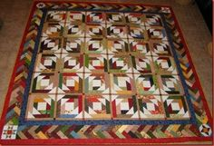 Bonnie Hunter Pineapple Quilt pattern.  Interesting colors...autumn reds, greens, blues, yellow/golds
