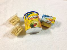 Take empty baby food containers and put baby snacks in them for travel. Makes the perfect serving size, saves space in the diaper bag and they don't get crunched!