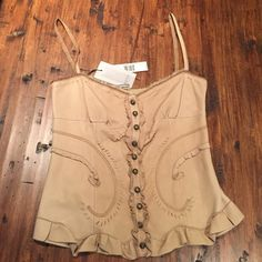 ❣Elie Tahari Franca Bustier Corset BRAND new with tags, Elie Tahari Corset. Shell made from fine leather (oatmeal color), inside is made from silk. Made in Italy. Soooo unique and beautiful. Huge discount at $500 OFF tag price!! Willing to negotiate :) Elie Tahari Tops