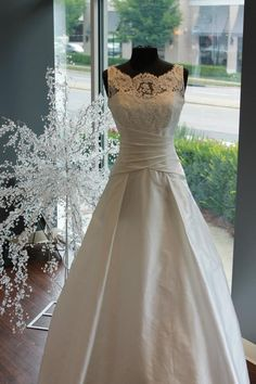 French Alencon lace, Bateu neckline, flattering draped waist! That's our Lovely Emily wedding gown....spotted at @Traditions !