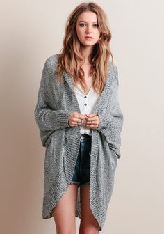 This comfy cardigan is perfect for layering over casual ensembles for a  hint of warmth on a chilly day. ddd03c923