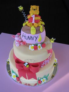 2 tiered Pooh Bear cake with rice crispy honey pot - pretty pretty