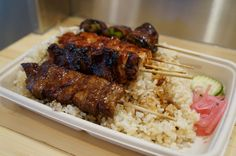 Bamboo Tori - Beef Tri Tips, Pork Belly, Chicken Thigh, Chicken Breast, and Bacon Asparagus yakitori over brown rice