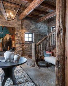 Rustic cabin decor! LOVE that bear and those beams!