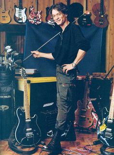 Eddie Van Halen smiling beside a few of his instruments of joy ... guitar collection  music studio -- and his golf clubs -DdO:) http://www.pinterest.com/DianaDeeOsborne/instruments-for-joy via Matthew Smith pin