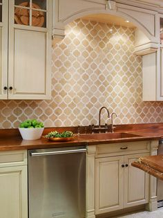 Arabesque backsplash...maybe just an accent of this over the stove surrounded by exposed brick just to give some variation in design
