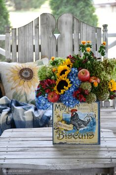 DIY transitional flower arrangement with biscuit tin | ©homeiswheretheboatis.net #hydrangeas #sunflowers #rooster Limelight Hydrangea, Blue Hydrangea, Hydrangeas, Flower Arrangement, Floral Arrangements, Cozy Meals, Seed Pods, Flower Centerpieces, My Flower