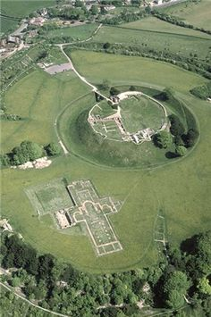 An aerial view of Old Sarum, Wiltshire, UK showing the motte and bailey castle and the remains of the Bishop's Palace. The Bishop's seat was transferred to nearby Salisbury in 1219 which gradually led to the decline of the Old Sarum site. When the settlement grew too big they needed to relocate so they decided to fire an arrow and where it landed they would build the new settlement, the arrow hit a deer and where the deer died they built Salisbury Cathedral