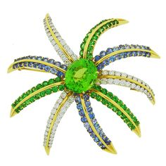 1993 Tiffany & Co. Peridot Tanzanite Diamond Platinum & Yellow Gold Brooch Pin | From a unique collection of vintage brooches at https://www.1stdibs.com/jewelry/brooches/brooches/