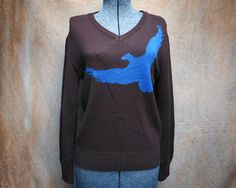 """Vintage Blue Eagle Sweater V-Neck Medium. Brown and Blue Eagle Knit Sweater, V-Neck  Fly like an eagle... maybe it is a pigeon? Fly away either way!  Details Chest: 38"""" Sleeve: 22.5"""" Length: 25"""" Shoulders: 18.5"""" V Depth: 5.5"""""""