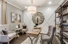 A oversized clock makes a big vintage-inspired statement! This piece features Roman numerals and a distressed finish to amplify its antique appeal. | Pulte Homes