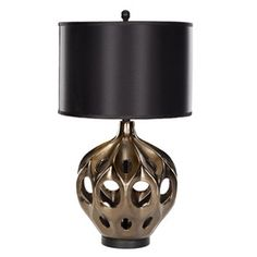 "Ceramic table lamp with a copper-hued openwork base and black drum shade.   29"" H x 16"" Diameter; $122."