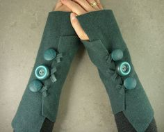 Great idea for fingerless gloves - felt an old sweater, cut it up and add buttons. Or buy this one for $26 on Etsy.