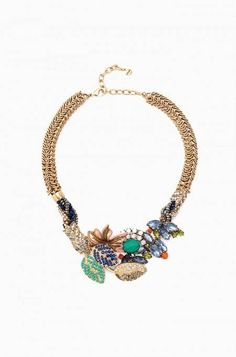 Semi precious pyrite beads braided with royal blue and sparkleconnects to a garden inspired collage of colors. This necklace will besure to make a statement with any outfit.