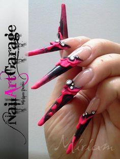 Alien Faces on Stiletto Nails