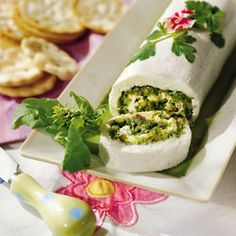 Easter Appetizers | Basil-Cheese Roulade | SouthernLiving.com-Creamy Basil-Cheese Roulade is as delicious with crisp French bread or crunchy vegetables as it is with crackers.