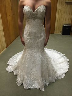 The crystal beading on this lace wedding gown gives great bling to the design. As custom dress makers we can produce custom #weddingdresses like this for you at a reasonable price.  We are located near Dallas Texas but can sell custom designs to you no matter where you reside in the world. We also make #replicaweddingdresses for brides who love a design that is out of their price range.  Your dress will still look similar but cost less.  Get pricing at www.DariusCordell.com