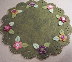 Pretty felt penny rug with flowers and buttons. Penny Rug Patterns, Wool Applique Patterns, Felt Patterns, Felt Applique, Penny Rugs, Fabric Crafts, Sewing Crafts, Felt Gifts, Felted Wool Crafts