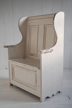 (Chapter 15) The settle was a long bench with a back for protection against drafts from the fireplace. Solid sides went up to the armrest with the corners extending upwards. The seat was sometimes hinged and had a box below.