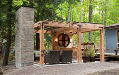 """""""Contemporary pergola with stone fireplace, comfortable seating and bar;"""" """"Outdoor bar and fireplace- covered and open roof"""" """"beautiful bar counter with wooden structure with modern looks"""" """"pergola with logs and bar"""" """"Fisher West Sussex England"""" """"ummer Home Outdoor Spaces"""" """"Round logs...Bar - Fonda...Like the bar area...has a bar too...logs on pergola"""""""