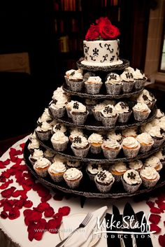 one way to have the wedding cake - only the topper you save and cupcakes.  I love the KISS theory.