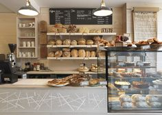London firm Paul Crofts Studio completed this bakery on a high street in Suffolk, UK, with a motif based on a magpie's nest set into the douglas fir serving counter.