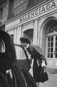 Bettina Ballard arriving by car to select clothing for the exhibit.    Photographed for LIFE Magazine.