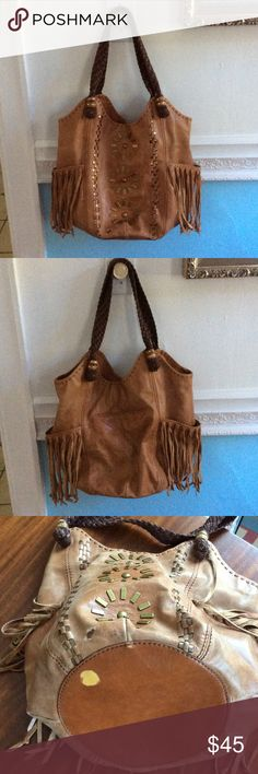 The Sak Large Brown Tassel Bag The Sak large tan bag with tassels and braided brown straps. Two zipper pockets on the inside. Very cute! Used and in good condition. Picture 3 shows the only damaged spots. Everything is perfect! This is a great bag The Sak Bags Shoulder Bags