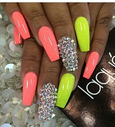 Coral, yellow and diamond coffin shape gel nails.