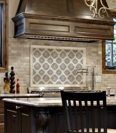 This kitchen backsplash is an example of the Artisan Stone Tile Cara Collection by Stone Impressions, created using Authentic Durango Stone™.