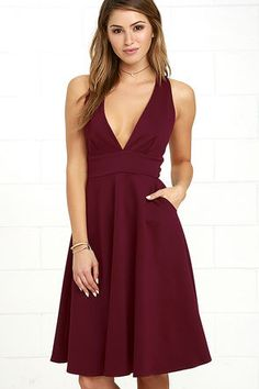 The Finesse Burgundy Midi Dress is a timeless addition to your wardrobe to keep you in style all year round! Medium-weight stretch knit forms a plunging V-neckline, and a sleeveless, darted bodice. Skater skirt (with front diagonal pockets) falls from a banded waist to a perfectly flirty midi length. Exposed gold back zipper.