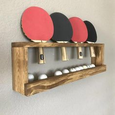Ping Pong Ball and Paddle holder. This is a custom, unique piece thats practical and stylish! Hangs flush to the wall creating a sleek and modern way to keep the paddle and balls off the floor. **Custom order welcome** This can be done in a number of Garage Game Rooms, Game Room Basement, Basement Bedrooms, Basement Ideas, Basement Plans, Teen Basement, Basement Ceilings, Basement Makeover, Basement Apartment