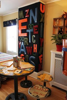 Ideas for the boys room.  Brightly colored letters, industrial seating