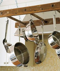 DIY pot rack.  Going to start my search for old wooden ladder (or a segment of one) now!