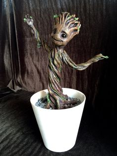 Hey, I found this really awesome Etsy listing at https://www.etsy.com/listing/221224728/full-scale-potted-groot-sculpture-from