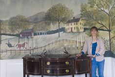 This mural was painted by Lisa Curry Mair on canvas and then mounted on the wall with wallpaper paste. The scene dates back to the mid 19th century. With a driving horse, colonial home and old barn. It was painted to mimic how the current home's surroundings would have looked almost 200 years ago.