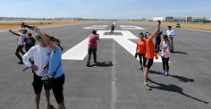 Description of . Runners made a record of the day as the Long Beach Airport hosted Run the Runway, a one-mile fun run on runway 25 right, that is being reopened after the runways renovations.    Long Beach Calif., Tuesday  March,31, 2015.     (Photo by Stephen Carr / Daily Breeze)
