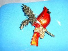 This is a very beautiful cardinal pin.I think it is vintage. Any ?????? just ask.  I ship in the U.S only.  Check out my Yardsale items here:http://yardsellr.com/yards?ale/Marla-Jones-198554