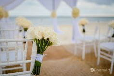 Beautiful wedding ceremony set up with white rose bouquets at @gvrivieramaya. Photo courtesy of #DreamArtPhotography.
