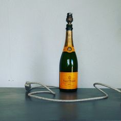 A must for all champagne lovers. Verve Cliquot bottle lamp with an #antique look.  #champagne #bottles #interior #design #decor #lighting #lamps #individual #handmade #individualfurnishings #berkshire. Made by www.individualfurnishings.com