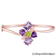 Help her make a dazzling fashion statement with this vibrant multi-gemstone bangle bracelet from the Catherine Malandrino™ Collection. Crafted in sterling silver with precious 18K gold plate, this splendid style features an intriguing cluster of multi-shaped and colored gemstones - including 7.0 x 7.0mm trillion-cut and octagon-shaped bright purple amethyst, round spring-green peridot and baguette-cut blush-pink rose quartz - atop a curvy polished cuff. Buffed to a brilliant luster, this