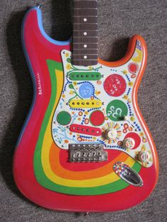 George Harrison's 1962 Fender psychedelic Stratocaster - he started to used it in it's painted form this way in 1967 - it's name is Rocky