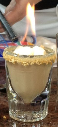 S'more Shooters:  12 large marshmallows or 35 mini-marshmallows  1 cup half & half  8 ounces bittersweet chocolate, chopped  1 ½ cups whole milk  ¾ cup amaretto  ½ cup graham cracker crumbs  Bacardi 151 or other flammable liquor